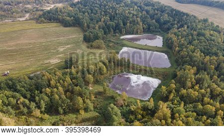 Aerial View Of Urban Sewage Filtration Ponds System. Sewage Farm. Ecology Concept.