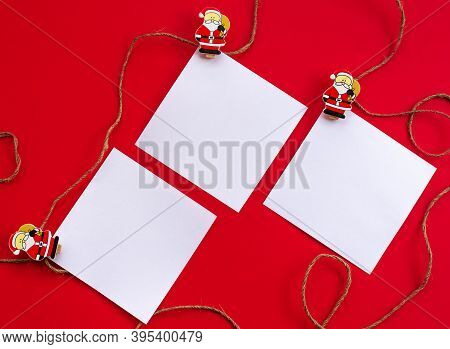 New Year's Holiday Background. White Sheets For Notes On Wooden Clothespins And Jute Rope With Figur