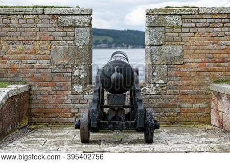 War Cannon At Barracks Complex In Historical Fort George Behind A Protective Wall, Scotland, Uk