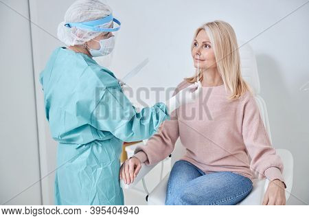 Woman Being Screened For Coronavirus In A Laboratory