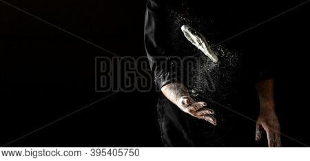 Chef Throwing Up Dough For Pizza On Black, Cook Hands Kneading Dough, Sprinkling Piece Of Dough, Lon