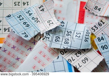 Torn Lottery Tickets With Numbers. The Concept Of Losing Money And Luck.