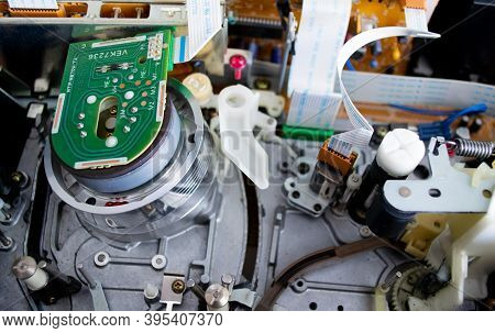 Moscow, Russia, October 2020: Close - Up Of Details Inside The Vcr. Transistors, Microchips, Etc. Te