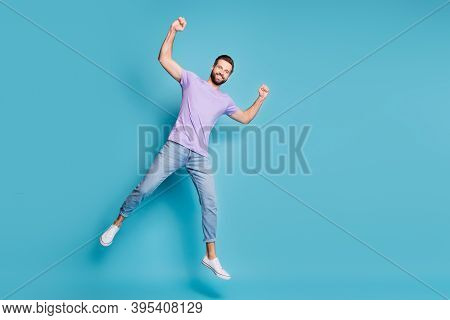Full Length Body Size Photo Of Young Student Jumping Showing Muscles Biceps Triceps Smiling Isolated