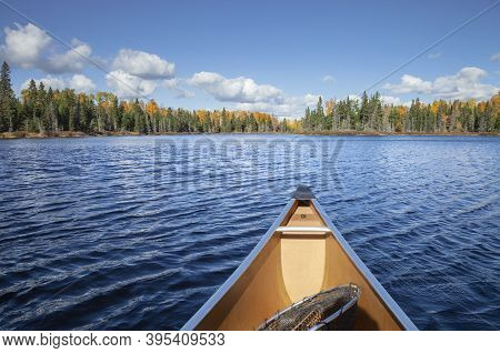 Canoe On A Blue Lake In Northern Minnesota During Autumn