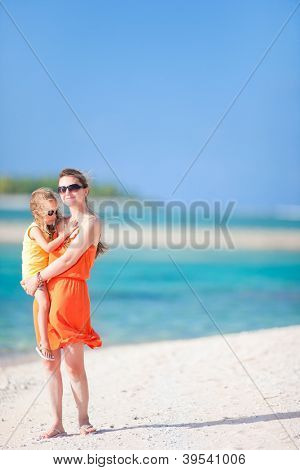 Beautiful mother and daughter on a tropical vacation