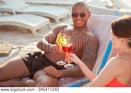 Handsome African Man With Athletic Muscular Body Clinking Glasses With His Girlfriend, Celebrating A