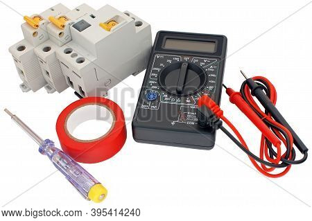 Insulating Tape, Modular Circuit Breaker And Digital Multimeter On White Background