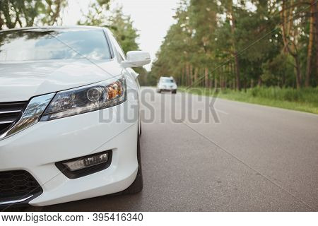 Cropped Close Up Of A White Car On The Side Of The Road, Copy Space. Automobile On Countryside Road.