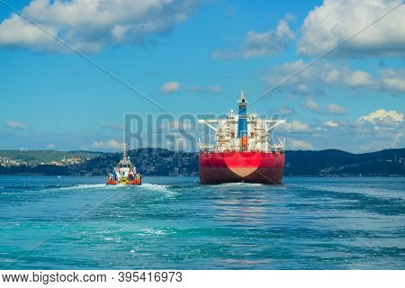 Giant Freighter And Coast Guard Boat Passing Through The Bosphorus Strait, Istanbul, Turkey. Turkish