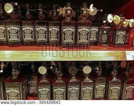 Whiskey Bottles On Display In Supermarket Shelves. Whiskey Jack Daniel's. Bottles Equipped With Anti