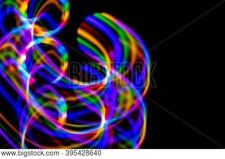 Multicolored Rainbow Lines On Black Background. Texture