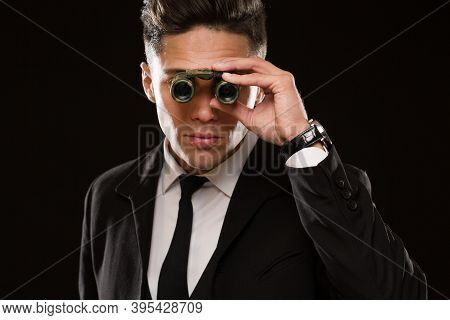 Close Up Shot Of A Professional Special Service Agent Or Bodyguard Looking Tot He Camera With Binocu