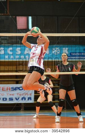 KAPOSVAR, HUNGARY - OCTOBER 14: Zsofia Horvath (in white) in action at the Hungarian I. League volleyball game Kaposvar (white) vs Nyiregyhaza (black), October 14, 2012 in Kaposvar, Hungary.