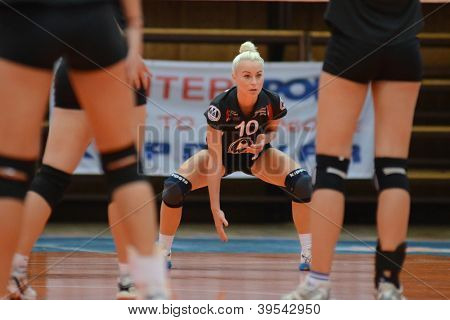KAPOSVAR, HUNGARY - OCTOBER 14: Virag Csitari (C) in action at the Hungarian I. League volleyball game Kaposvar (white) vs Nyiregyhaza (black), October 14, 2012 in Kaposvar, Hungary.