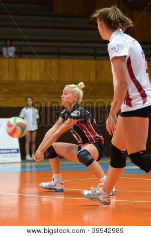 KAPOSVAR, HUNGARY - OCTOBER 14: Virag Csitari (in black) in action at the Hungarian I. League volleyball game Kaposvar (white) vs Nyiregyhaza (black), October 14, 2012 in Kaposvar, Hungary.