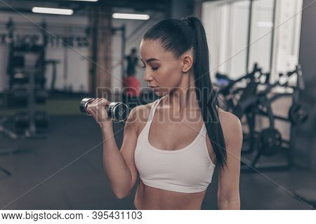Dark Haired Young Female Athlete Exercising At Gym Studio. Profile Shot Of A Beautiful Sportswoman L
