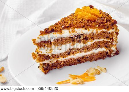 Carrot Cake With Walnuts. Piece Of Cake On A Plate. Sweet Food. Sweet Dessert. White Background.