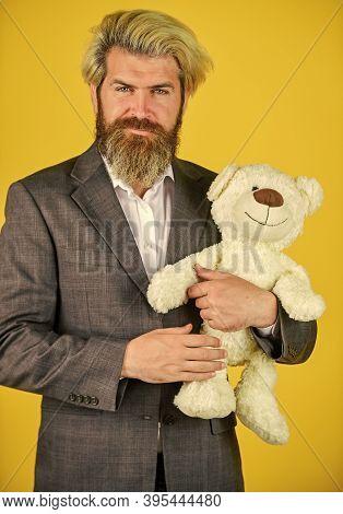 Friendly Relations. Imaginary Friend. Still Childish In Soul. Happy Businessman Hug Teddy Bear Yello