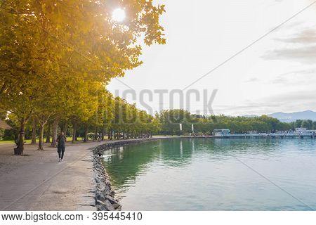 Klagenfurt, Austria- August 26, 2020: People Walking And Relaxing On The Lake Worthersee Promenade,
