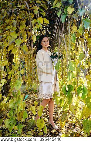 Warm Autumn Portrait Of Young Pretty Woman.