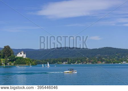 Klagenfurt, Austria- August 26, 2020: Boating And Sailing On The Clear Waters Of Alpine Lake Worther