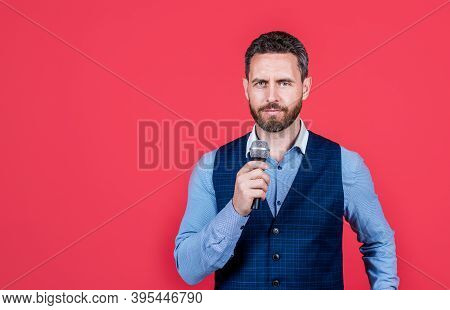 Experience Karaoke Like Never Before. Karaoke Singer Red Background. Singing Along To Recorded Music
