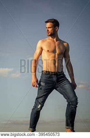 Muscular Bare Torso. Six Packs Muscular Chest. Man Outdoors Blue Sky Background. Summer Trends. Male