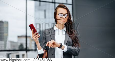 A Business Woman Checks The Time In The City During A Working Day Waiting For A Meeting. Discipline