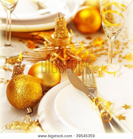 Picture of Christmas table setting still life, festive white utensil decorated with golden candle and shiny xmas tree ball toys, romantic holiday dinner, New Year party, luxury table decorations