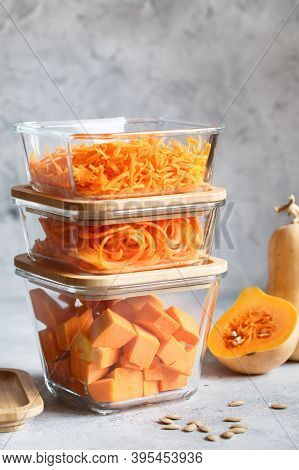 Glass Boxes With Fresh Raw Orange Vegetables. Finaly Shredded Pumpkin And Big Pieces. Healthy Meal P