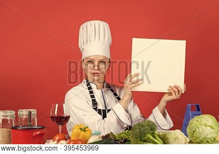 Begin Tallying Calories. Work In A Modern Kitchen. Woman Chef Read Cookbook. Can Be Used For Cooking