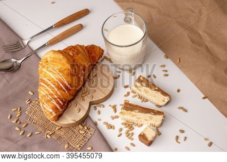 Big Croissant, A Glass Of Milk And Slices Of Sweet Sorbet.