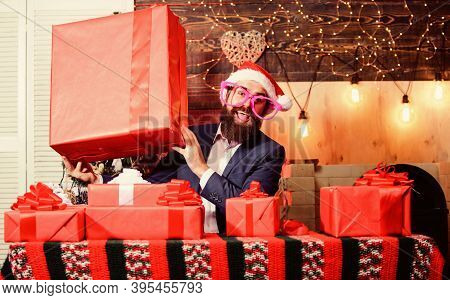 Size Matters. Man Santa Claus Hat Carry Big Gift Box. Biggest Gift For Christmas. Celebrate Christma