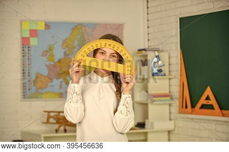 Science And Technology. Mathematics Matters. Small Child Holding Ruler For Mathematics Lesson. Cute
