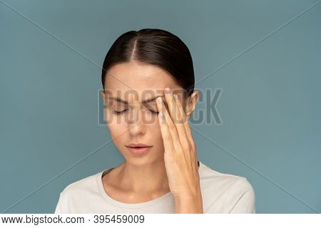 Woman Feeling Headache, Weakness, Massaging Temples, Tired, Exhausted From Overwork In Office Over B