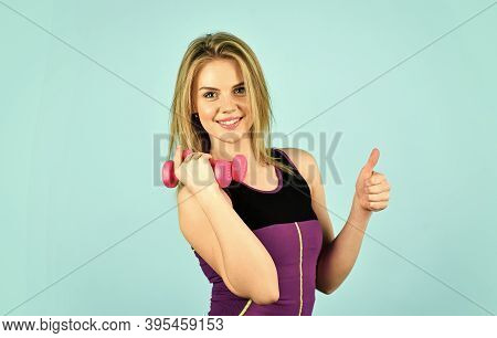 Be Successful. Girl Use Barbell Blue Background. Slim Girl Doing Triceps Exercise With Dumbbell In T