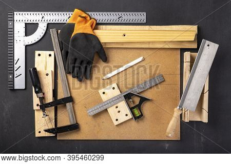 A Table In A Home Carpentry Workshop. Woodworking Accessories At The Carpenter's Stand.
