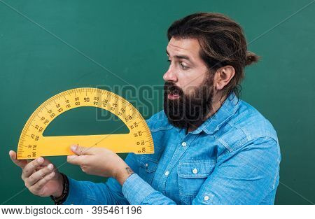 Man Surprised With Size Measured On Protractor Ruler Math Tool, School Stem Disciplines