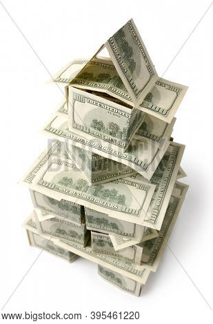 Tower made from dollar bills. Isolated on white background with clipping path.