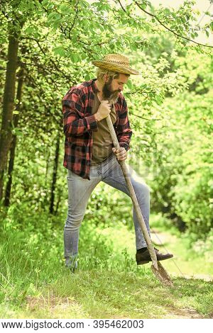 Gardener Agricultural Worker With Garden Tools. Caucasian Farmer Countryside Nature Background. Tool