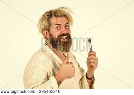 Great Time At Home. Man In Underwear. Hygiene. Man In Terry Bathrobe Brush Teeth In Bathroom. Mature