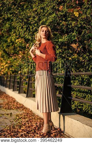 Autumn Fashion. Female Beauty. Femininity And Tenderness. Sunny Day With Fallen Leaves. Fall Fashion
