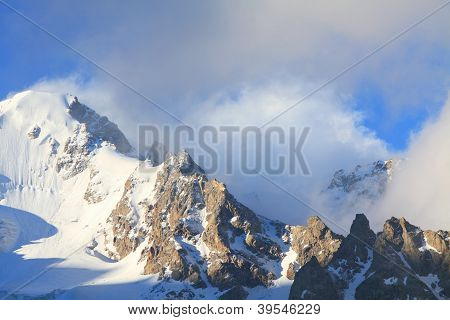 Snow-capped Peaks And Clouds