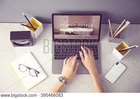 Woman Searching Hotel Using Laptop At Table, Top View. Booking Online Service