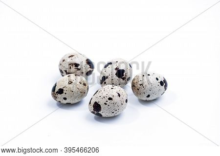 Quail Eggs Isolated On White Background. Group Of Quail Eggs Close-up Isolated On A White Background