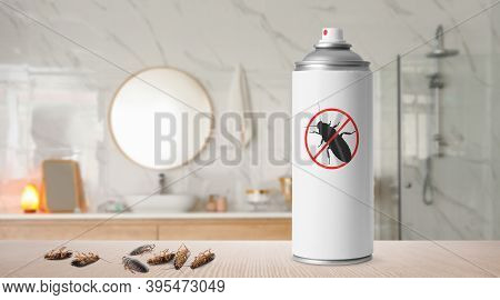 Pest Control. Insecticide And Dead Cockroaches On Table In Bathroom, Space For Text