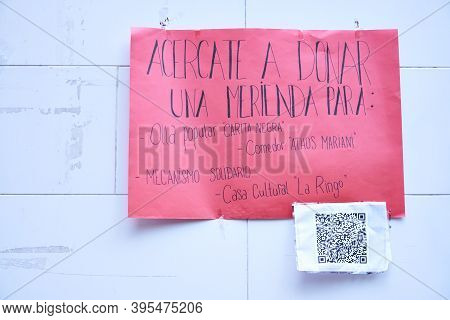 Buenos Aires / Argentina; Nov 14, 2020: Poster On A Street Wall Asking For Donations Of Food For Com