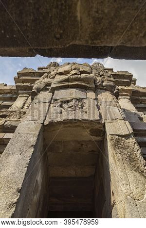 Huge Carved Stone Face, In One Of The Shrines Of The Prambanan Ancient Hindu Temple Complex, Rara Jo