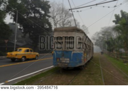 Blurred Image Of Electric Tram Is Passing Through Tram Lines At Kolkata Maidan Area. It Is The Only